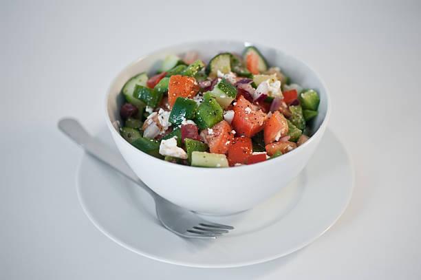 Bowl of greek salad stock photo