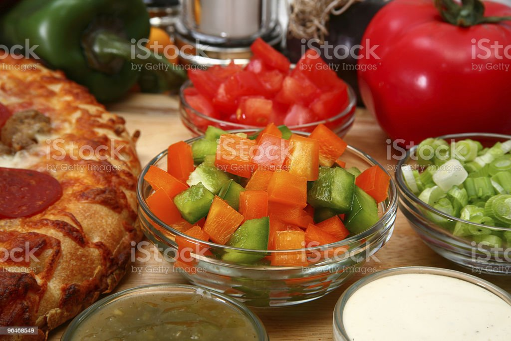 Bowl of Green and Orange Bell Peppers Chopped royalty-free stock photo