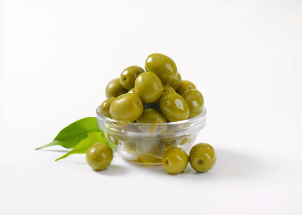 bowl of green olives stock photo
