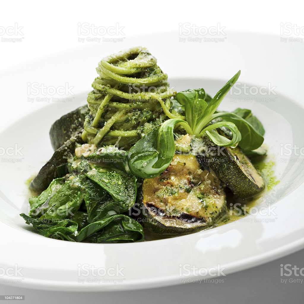 Bowl of green spaghetti and vegetables stock photo