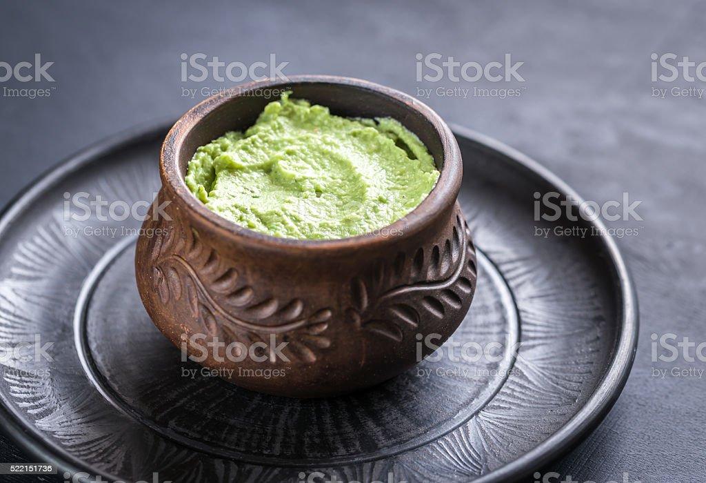 Bowl of guacamole hummus stock photo