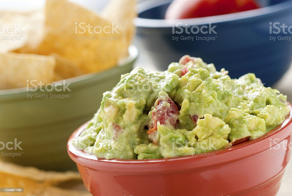 Bowl of guacamole ready to eat stock photo