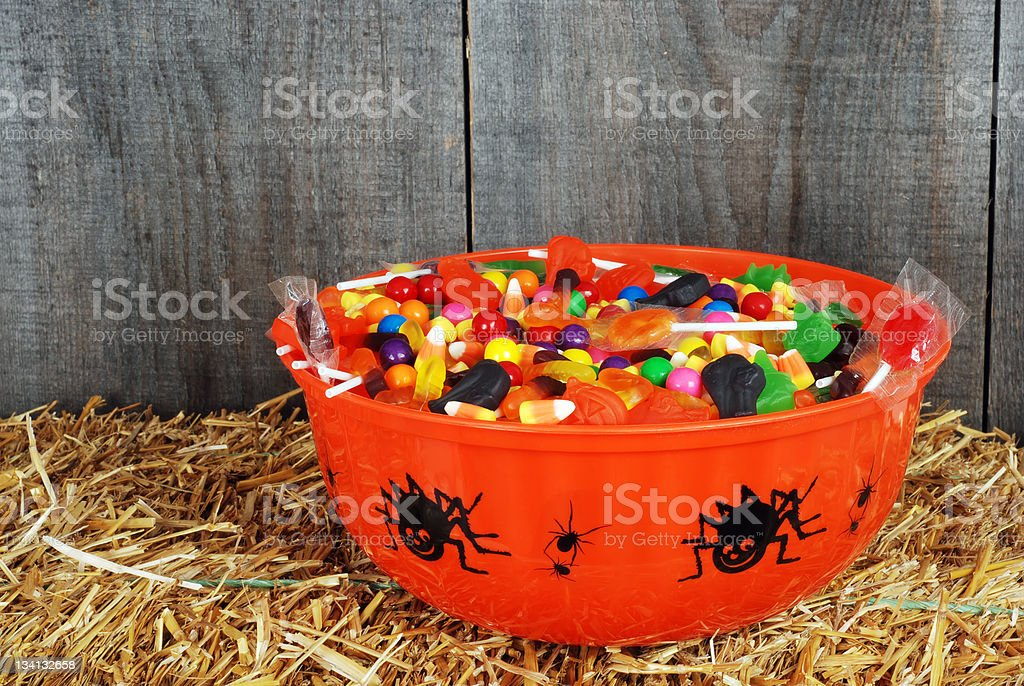 bowl of halloween candy on straw royalty-free stock photo
