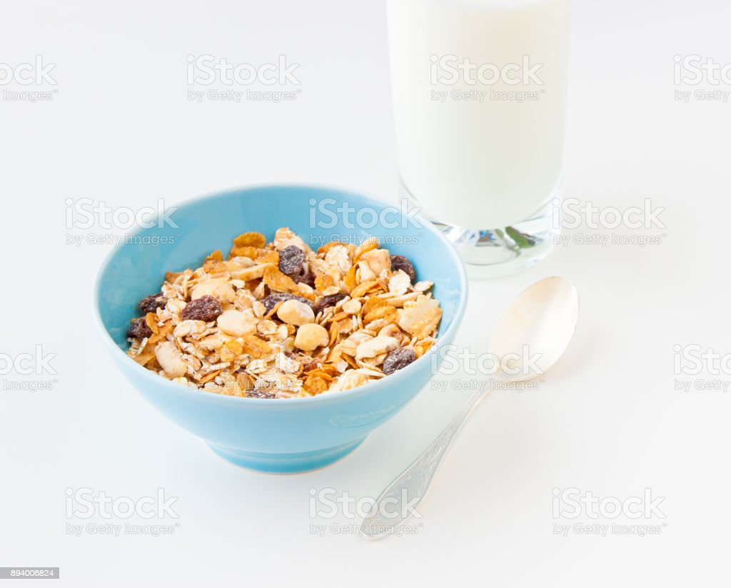 Bowl of healthy cereal with dry fruits and nuts  and a glass of milk stock photo