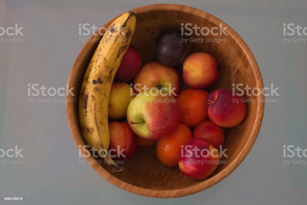 Bowl of healthy Fruits stock photo