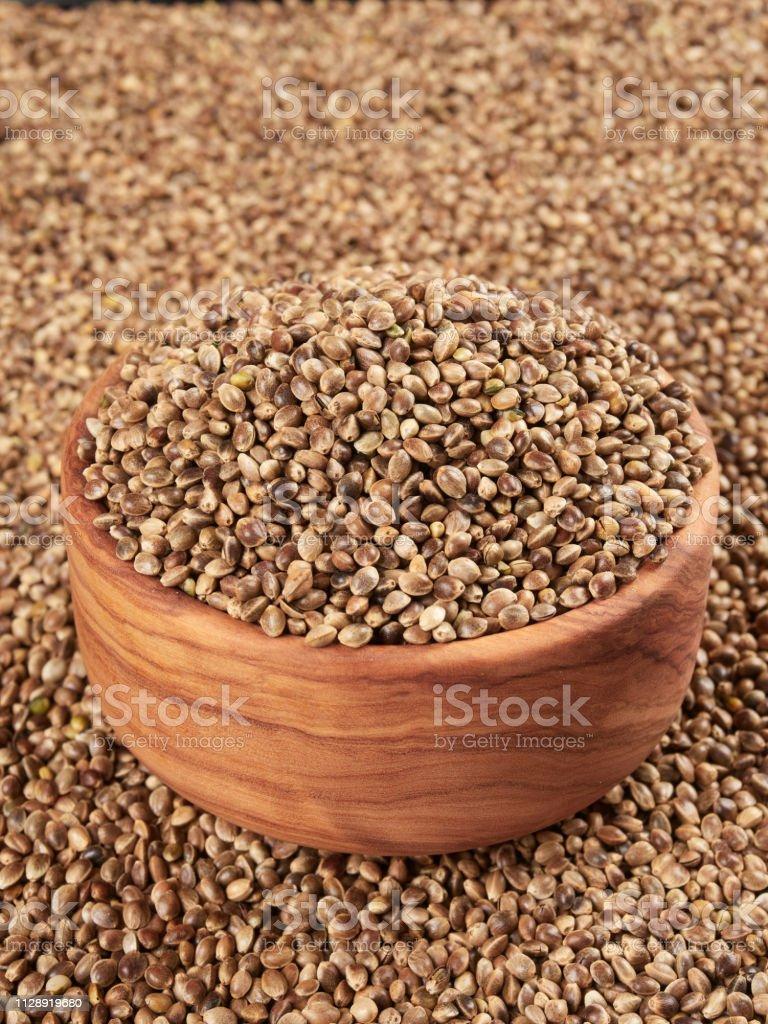 Bowl of hemp seeds stock photo