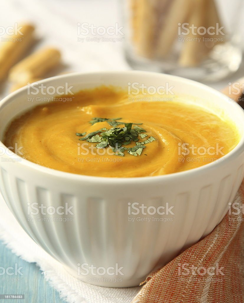 Bowl of homemade carrot soup with coconut milk and coriander royalty-free stock photo