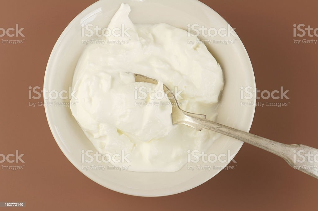 Bowl of Homemade Creme Fraiche on Brown Background stock photo