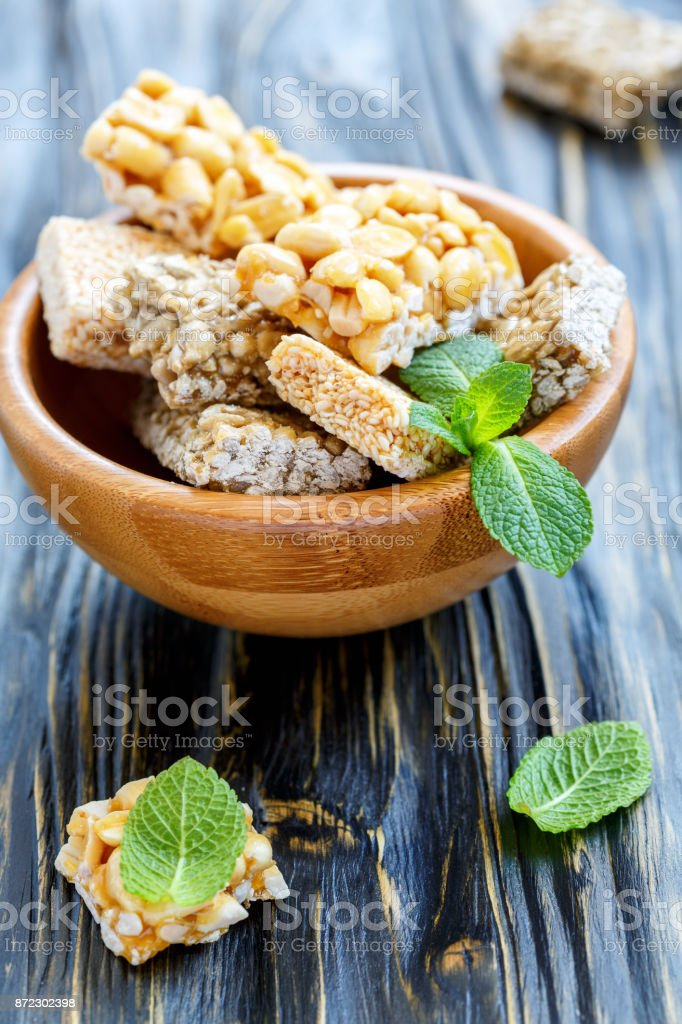 Bowl of honey bars with peanuts, sesame seeds and sunflower seeds. stock photo
