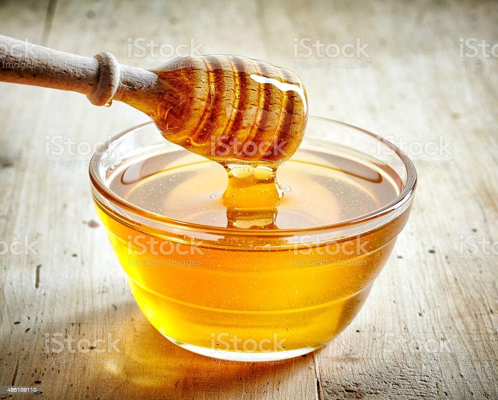 bowl of honey stock photo