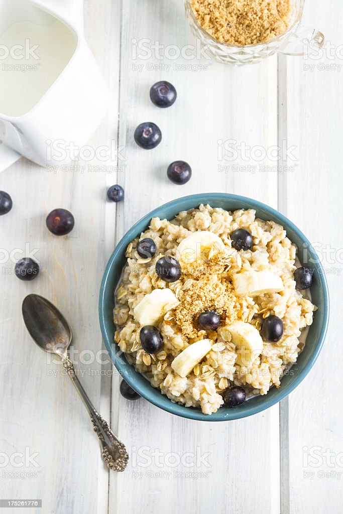 Bowl Of Hot Oatmeal With Blueberries and Banana Slices stock photo