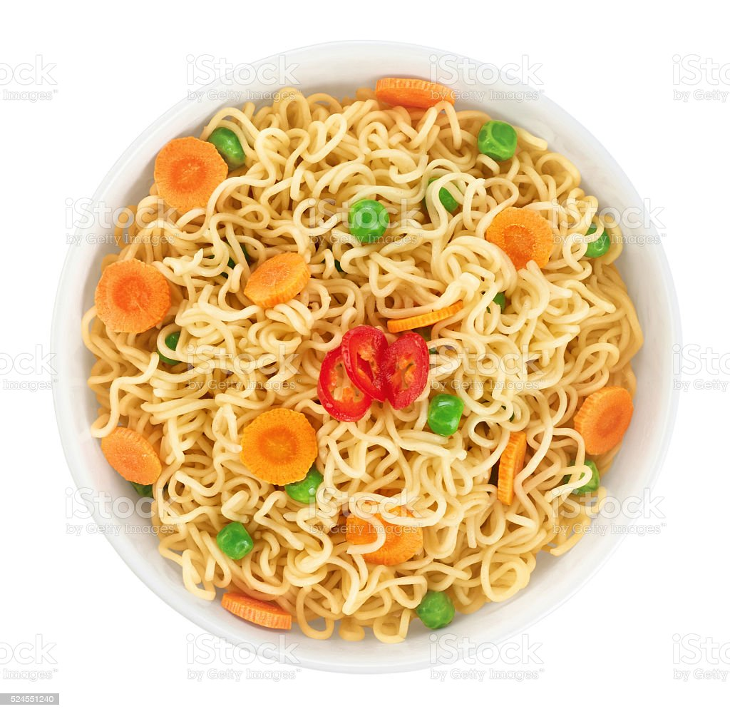 Bowl of instant noodles with peas, carrots and chili stock photo