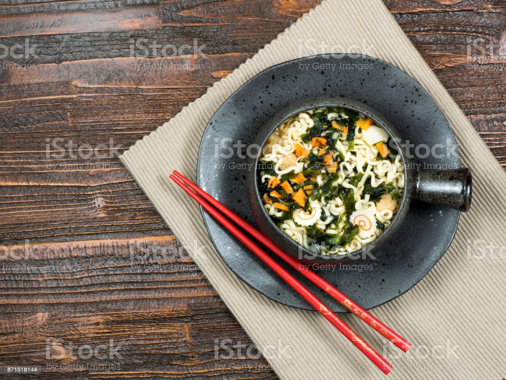 Bowl of instant noodles with vegetables stock photo