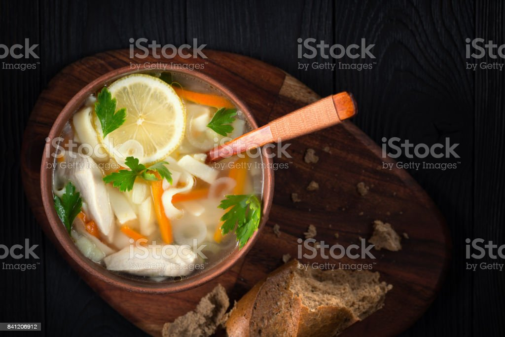 Bowl of Italian chicken soup, rustic style, view from above stock photo
