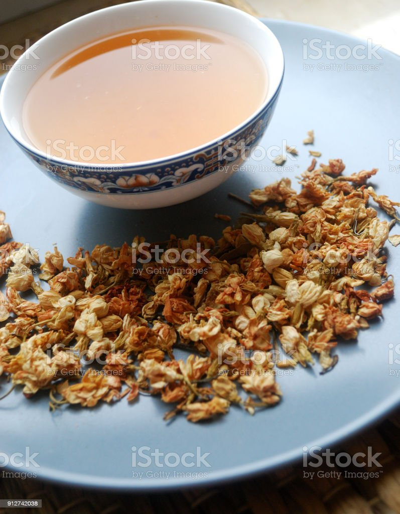 Bowl Of Jasmine Tea With Dried Flower Buds Stock Photo More