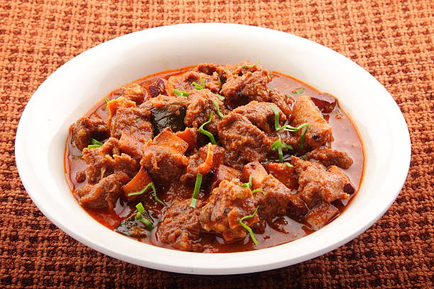 Bowl of lamb curry. Tasty lamb curry from Asian cuisine. curry powder stock pictures, royalty-free photos & images