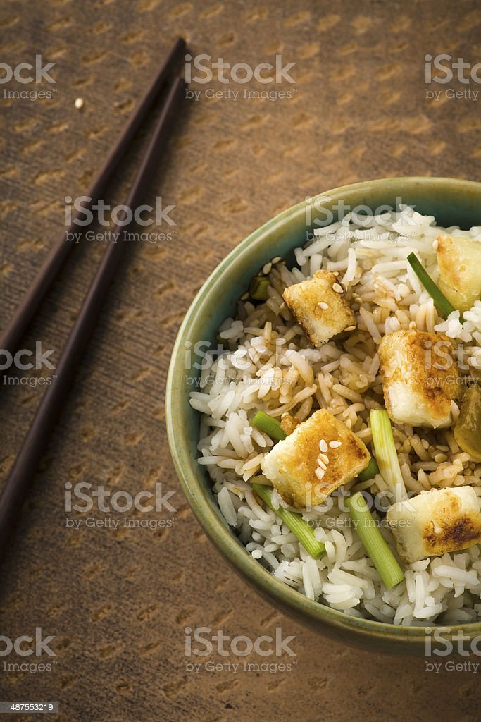 Bowl of lemon Rice with wild garlic and fried cheese stock photo