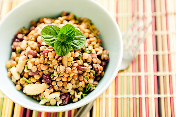 Bowl of lentil salad on table mat stock photo