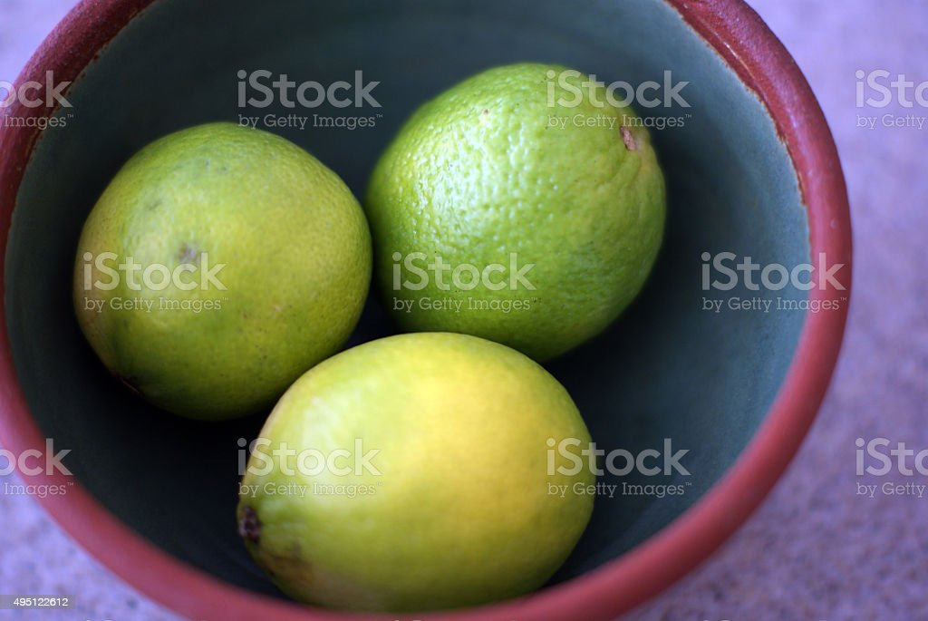 Bowl of Limes stock photo