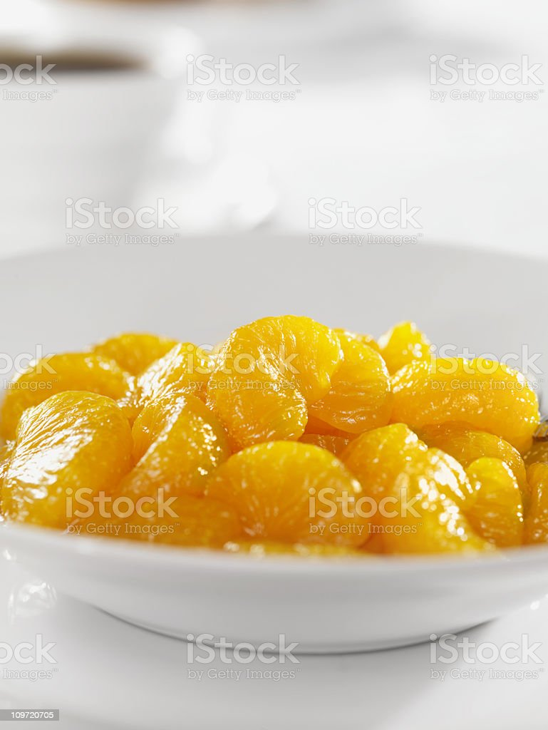 Bowl of Mandarin Oranges with Coffee royalty-free stock photo