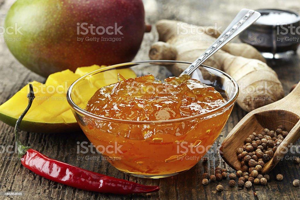 Bowl of Mango Chutney on wooden table stock photo