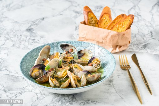 Freshly steamed Manila Clams dish with white wine,chili pepper and parsley