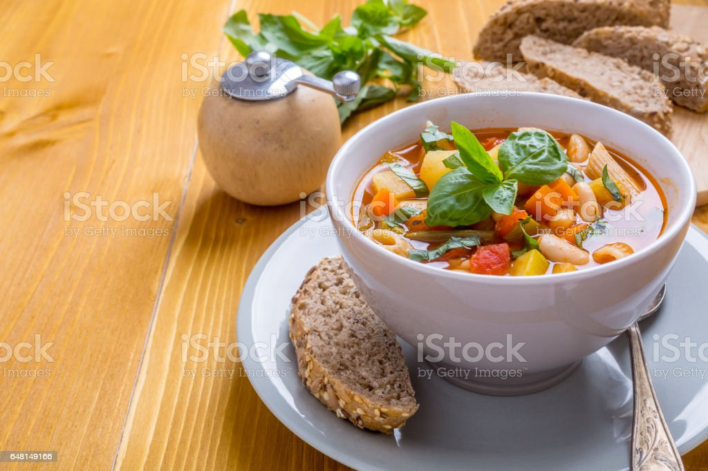 Bowl of Minestrone Soup with Pasta, Beans and Vegetables stock photo