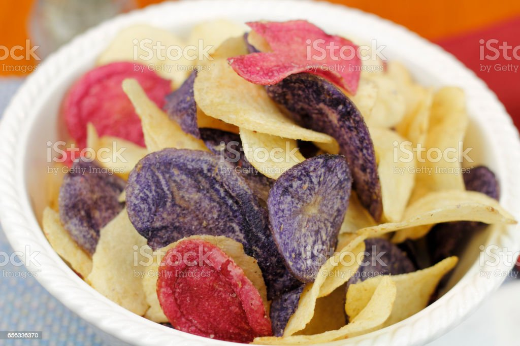 Bowl of Mixed Potato Chips Close-Up stock photo