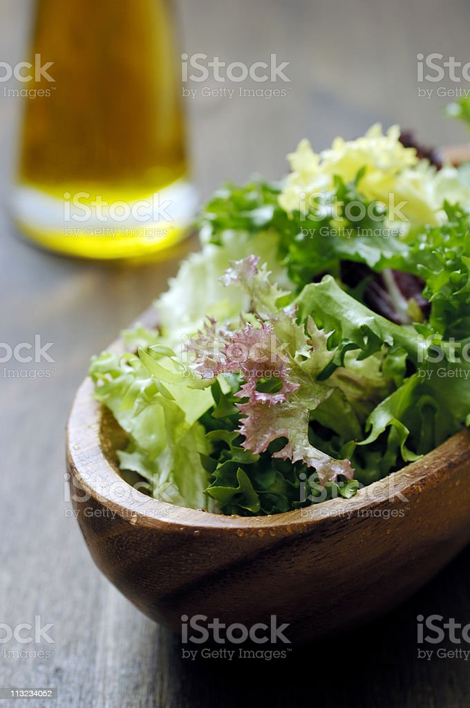 bowl of mixed salad with oil royalty-free stock photo