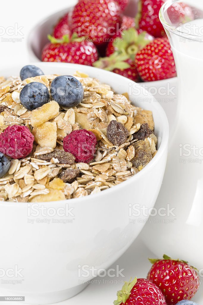 Bowl of muesli with fresh berries and milk royalty-free stock photo