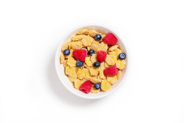 bowl of multigrain cornflakes and berries stock photo