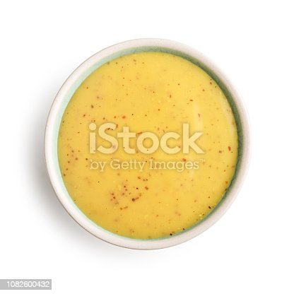Bowl of mustard and honey sauce isolated on white background, top view