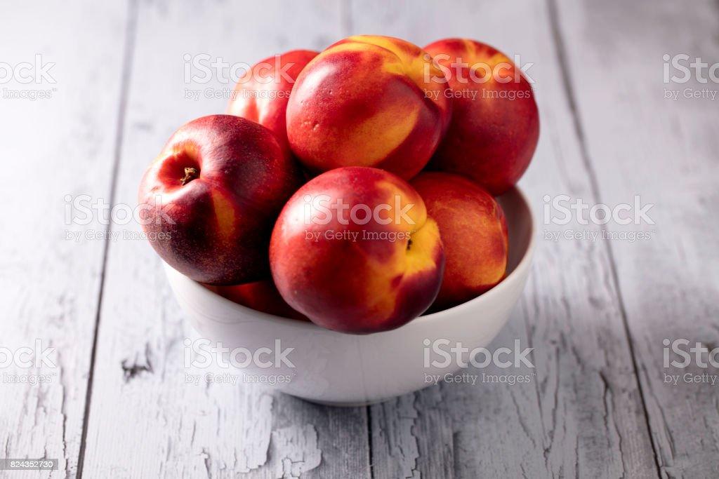 Bowl Of Nectarines stock photo