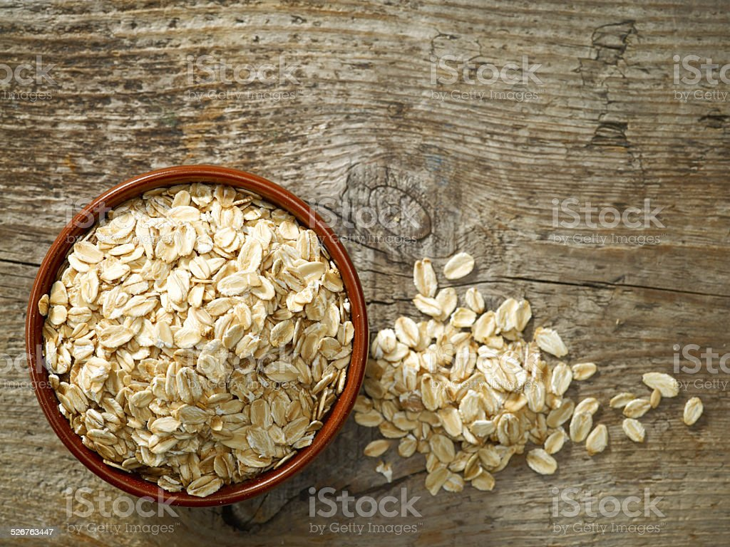 bowl of oat flakes stock photo