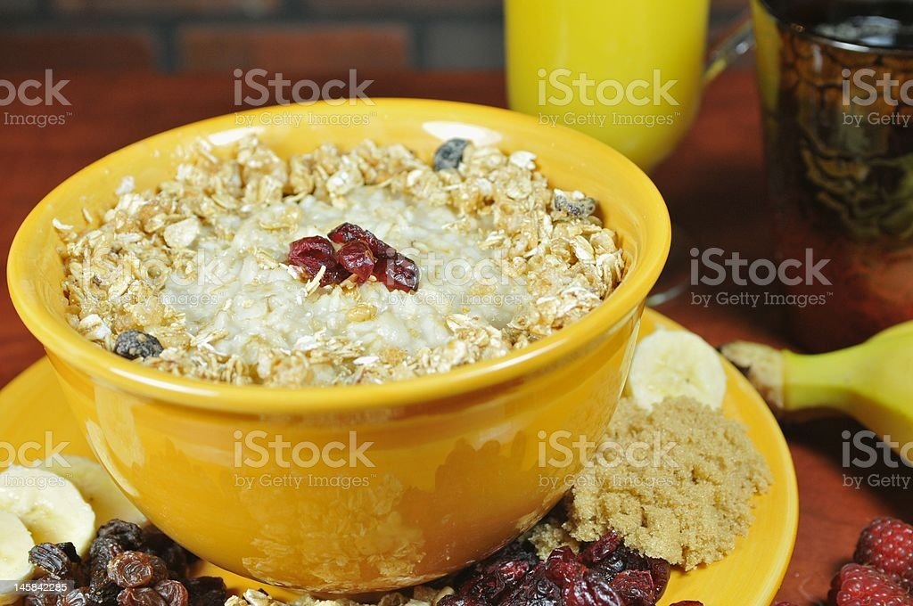 Bowl of oatmeal on table royalty-free stock photo