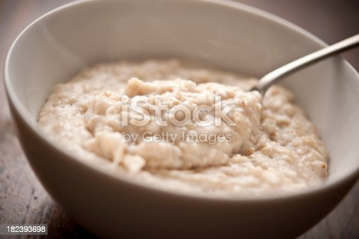 Bowl of oatmeal (porridge). Shallow focus.