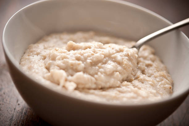 bowl of oatmeal Bowl of oatmeal (porridge). Shallow focus. oatmeal stock pictures, royalty-free photos & images