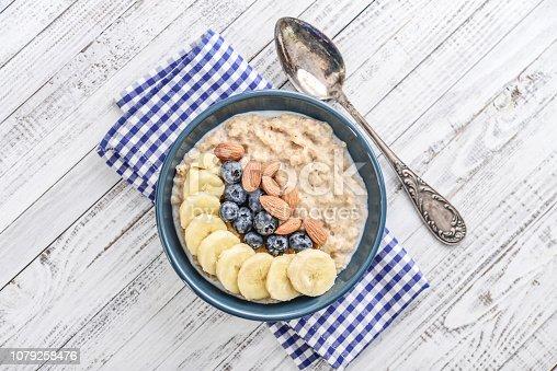 825171518istockphoto Bowl of oatmeal porridge 1079258476