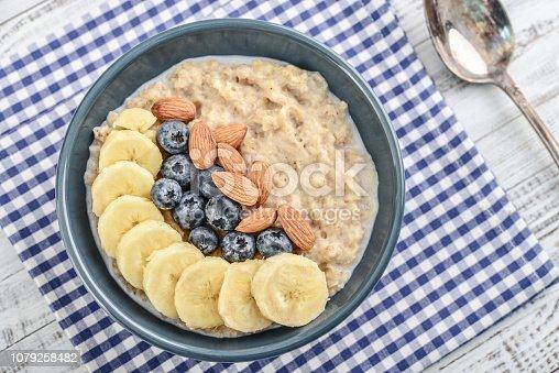 825171518istockphoto Bowl of oatmeal porridge 1079258482