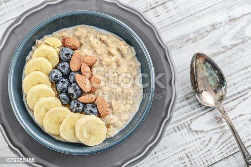 825171518istockphoto Bowl of oatmeal porridge 1079258488