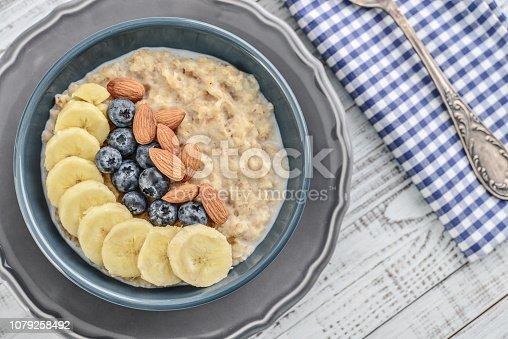 825171518istockphoto Bowl of oatmeal porridge 1079258492