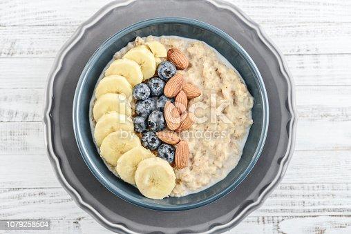 825171518istockphoto Bowl of oatmeal porridge 1079258504