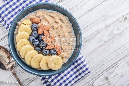 825171518istockphoto Bowl of oatmeal porridge 1079258506