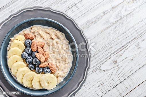 825171518istockphoto Bowl of oatmeal porridge 1079258516