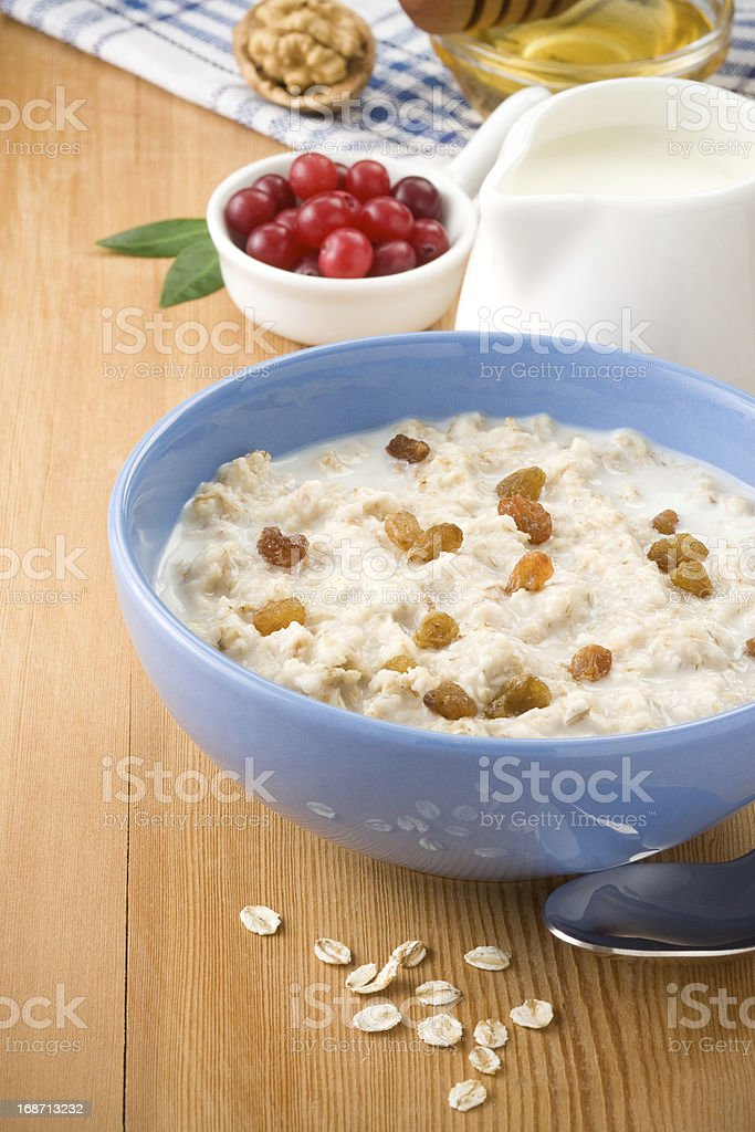 Bowl of oatmeal with berry and milk royalty-free stock photo
