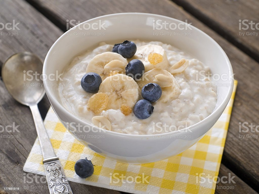 Bowl of oatmeal with blueberries and bananas stock photo