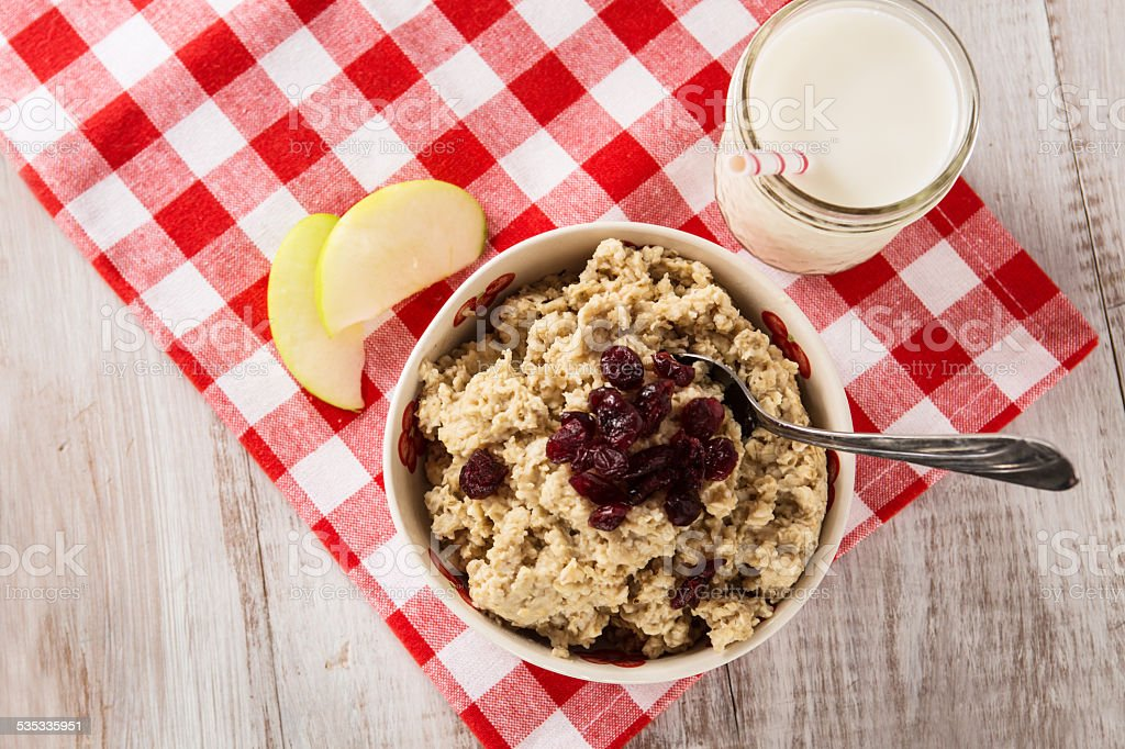 Bowl of Oatmeal With Cranberries and Apples and Milk stock photo