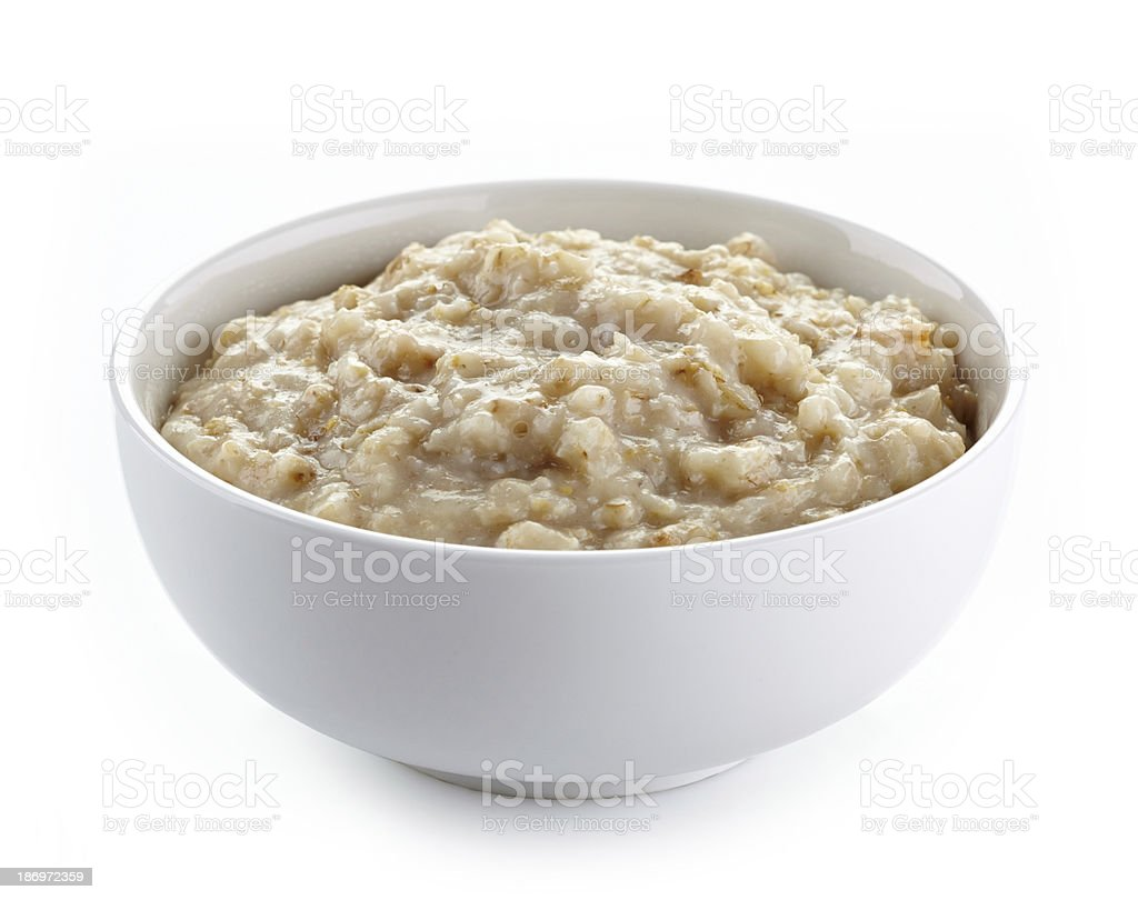 Bowl of oats porridge stock photo