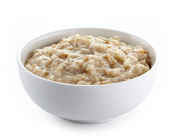 Bowl of oats porridge Bowl of oats porridge on a white background oatmeal stock pictures, royalty-free photos & images