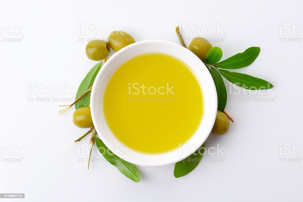 Bowl of olive oil stock photo